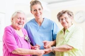 Elderly care nurse with two senior women